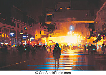 man standing on street looking at futuristic city at night