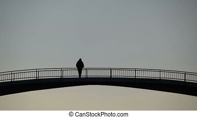 man standing on the bridge