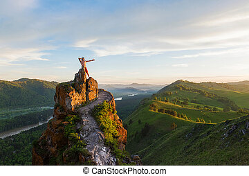 Man standing on top of cliff