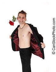 Man standing shirtless in an open jacket