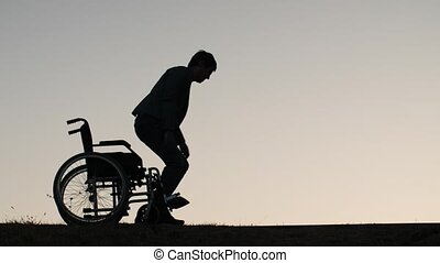 Man standing up from the wheelchair