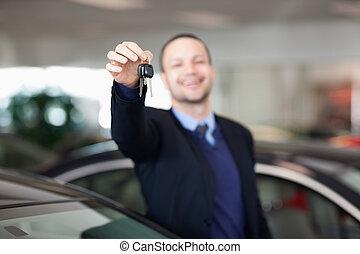 Man standing while holding car keys