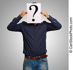 Man standing with a question mark board