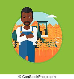 Man standing with combine on background. - An...