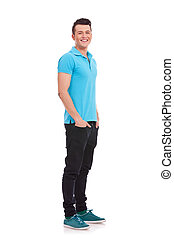 man standing with hands in pockets