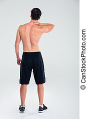 Man standing with neck pain - Back view portrait of a man ...