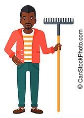 Man standing with rake.