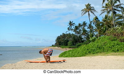 Man standing with surfboard in the beach 4k - Senior man...