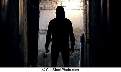 Man stands in dark tunnel