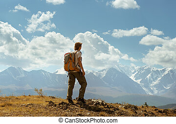 Man stands on the mountains background