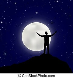 man stands on top of a mountain with his hands raised against the moon