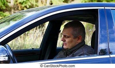 Man starts driving the car