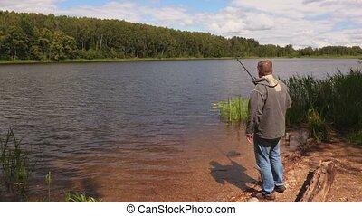 Man starts fishing in the lake