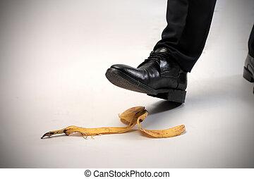 Man stepping on banana