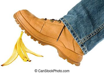Man stepping on banana peel. isolated on white background