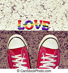 man stepping on the asphalt and the word love - closeup of...