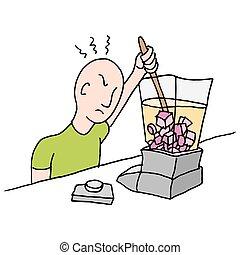 man stirring a stuck blender - An image of a man stirring a...