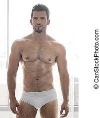 Man - Very sexy young male muscular model in white underwear...
