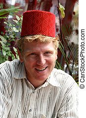 Man with a traditional fez hat.