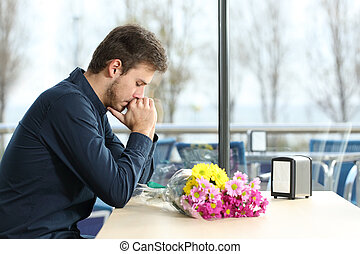 Man stood up in a date by his girlfriend - Sad man with...