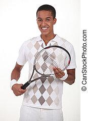 Man stood with tennis racket