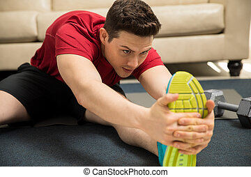 Man stretching his legs and working out