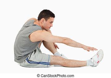 Man stretching up