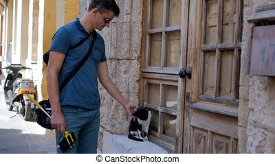 man stroking a cat