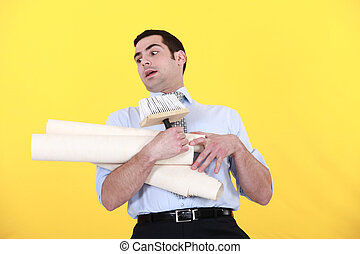 Man struggling to carry wallpaper