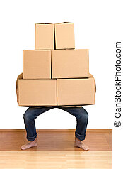 Man struggling while lifting lots of cardboard boxes -...