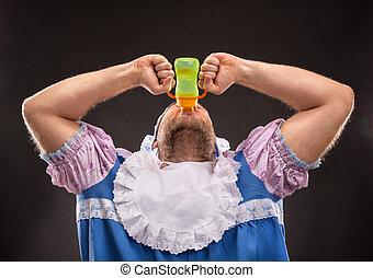 Man sucking a baby bottle