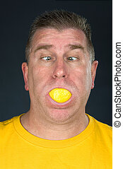 Man sucking on lemon - A man sucks on a very sour lemon...