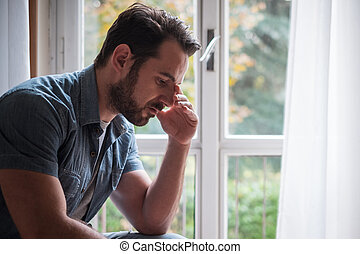 Man suffering and feeling alone at home