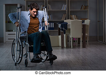 Man suffering from depression at wheelchair