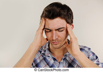 Man suffering from headache - Mid adult man suffering from...