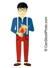 Man suffering from heartburn. - An asian man suffering from ...