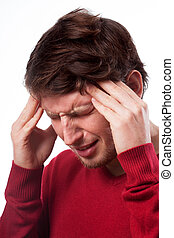 Man suffering from migraine