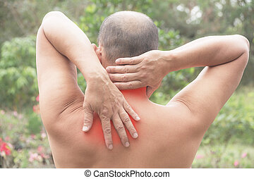 Man suffering from neck and shoulder pain. Acute pain in a man muscle concept with red spot.