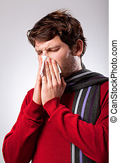 Man suffering from running nose - Ailing young man suffering...