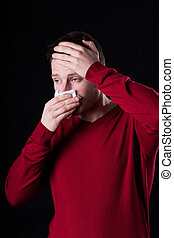 Man suffering from running nose