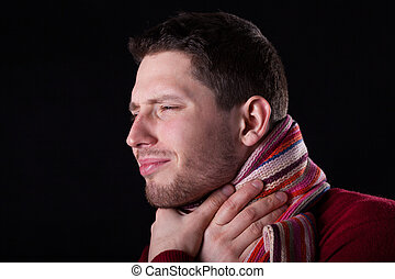 Man suffering from sore throat on isolated background