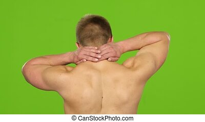 Man suffers from pain in neck, back view. Green screen - Man...