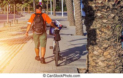 man sunrise time bike in park outdoor