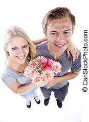 man surprised woman with bouquet