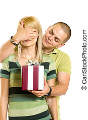 man surprising a woman with present