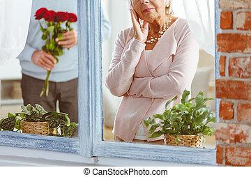 Man surprising sad woman