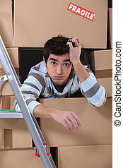 Man surrounded by cardboard boxes