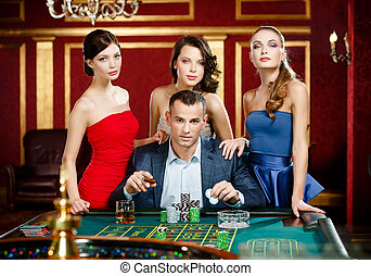 Man surrounded by ladies gambles roulette