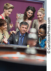 Man surrounded by women accepting of loss