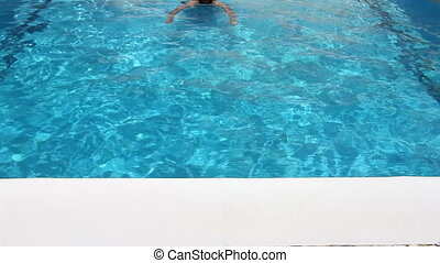 man swim in swimming pool